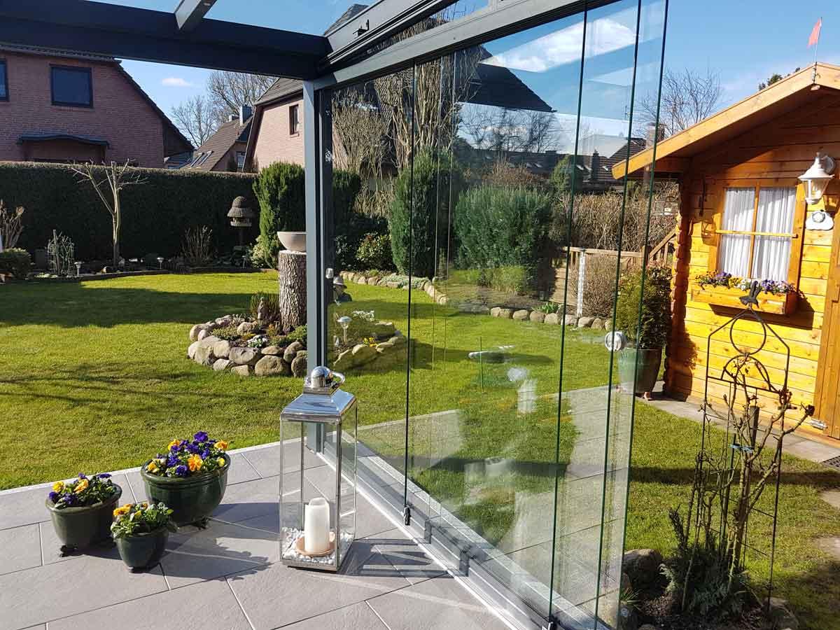 Sommergarten mit Glaswand Hanse-Carport